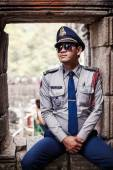 Cambodian Police officer at Angkor Wat temple — Stock Photo