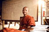 Buddhist monks learning on classroom — Stock Photo