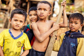 :Portrait of an unidentified Khmer boys on Tonle Sap Lake in Kampong Phluk, — Stock Photo