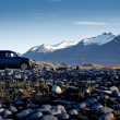 Generic SUV or all terrain car in Icelandic badlands — Stock Photo #53883647
