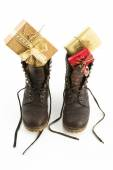 Leather boots filled with presents — Stock Photo