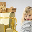 Little girl with christmas present — Stock Photo #59588791