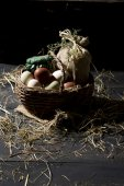 Easter eggs in a basket with straw — Stock Photo