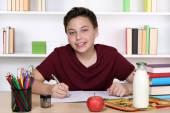 Boy doing homework at school — Stock Photo