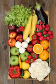 Shopping at market fruits and vegetables in box from above — Stock Photo