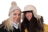 Two smiling women in winter with scarf and caps — Stock Photo