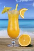Orange juice fruit drink on the beach — Photo
