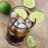 Cold Cola drink with limes — Stok fotoğraf