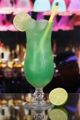 Green fruit cocktail in a bar or club — Stock Photo