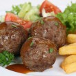 Meatballs meal with french fries and lettuce — Stock Photo #58742821