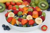 Fruit salad in a bowl with fruits like strawberries, blueberries — ストック写真