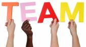 Multi ethnic group of people holding the word Team — Stock Photo