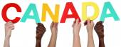 Multi ethnic group of people holding the word Canada — Stock Photo