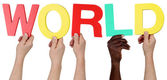 Multi ethnic group of people holding the word world — Stock Photo