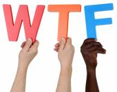 Multi ethnic group of people holding the word WTF — Stock Photo