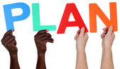 Multi ethnic group of people holding the word plan — Stock Photo