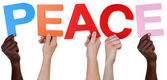 Multi ethnic group of people holding the word peace — Stock Photo