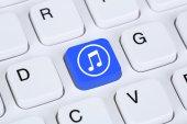 Listening to music on internet computer — Stock Photo