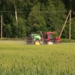 Farmer spray wheat field summer season, herbicides, pesticides — Stock Video