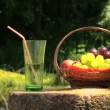 Glass water fruit on stone table, girl enjoying warm weather — Stock Video #52744891