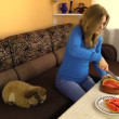 Pregnant woman cut watermelon and put on table in living room. — Stock Video #52891943