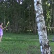 Pregnant woman with daughter girl play badminton game in park — Stock Video #54193015
