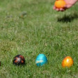 Hand throw colorful eggs on grass. Traditional Easter games — Stock Video #54487131