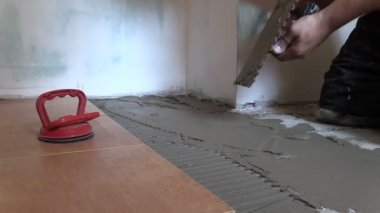 Tiler worker hand spread adhesive material. Right side sliding — Video Stock