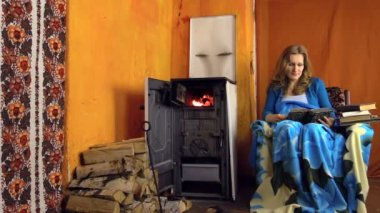 Woman read book sit on armchair on cold winter day. Zoom in — Video Stock