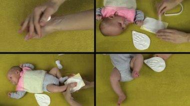 Hands make newborn baby footprint palm mark. Video collage. — Stock Video