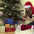 Mother show newborn daughter in christmas dress fir toy ball — Stock Video #68470975