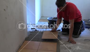 Handyman worker place floor tiles. Home improvement, renovation — Stock Video