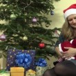 Mother with infant baby have fun near fir tree and presents — Stock Video #69637855