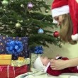 Mother with Santa hat with infant daughter in christmas dress — Stock Video #71032817