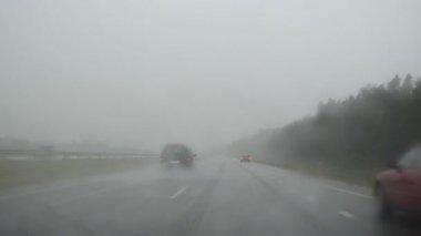 The rain falls terrible highway cars image the car windscreen — Stock Video