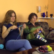 Grandma with girl knit needles on couch, experience, hobby craft — Stock Video #73378407