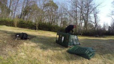 Gardener farmer man assemble plastic compost box. Timelapse. 4K — Stock Video