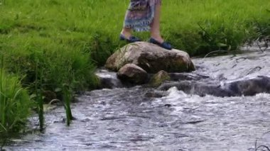 Pregnant woman on stone and let paper origami ship float water — Stock Video