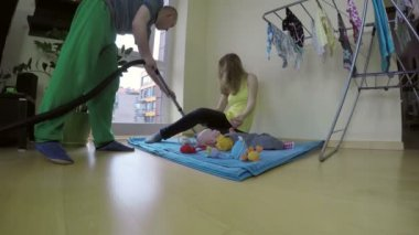 Father hoover floor and mother play with baby. Happy family. 4K — Stockvideo