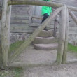 Woman come out of rural house through wooden gate. 4K — Stock Video #78688682
