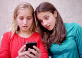 Young teenage girls using her cellphone — Stock Photo