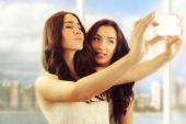 "Friends making selfie. Two beautiful young women making ""selfie"" — Stock Photo"