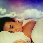 Portrait of young beautiful woman in bed. — Stock Photo