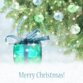 Blue christmas gift on glitter shiny background with stars. — Stock Photo