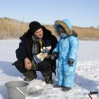 Winter fishing with grandpa — Stock Photo #63270619