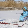 Winter fishing Young fisherman — Stock Photo #63270667