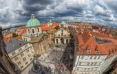 Panorama of red roofs of Prague and Charles Square — Stock Photo