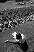 B&W of girl setching flowers. — Stock Photo