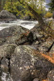 Large boulders by river. — Stock Photo