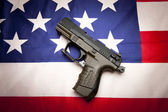 Concept of pistol on the flag. — Stock Photo